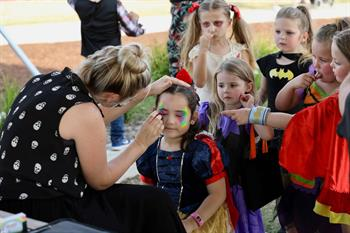 Children lining up to get their face painted
